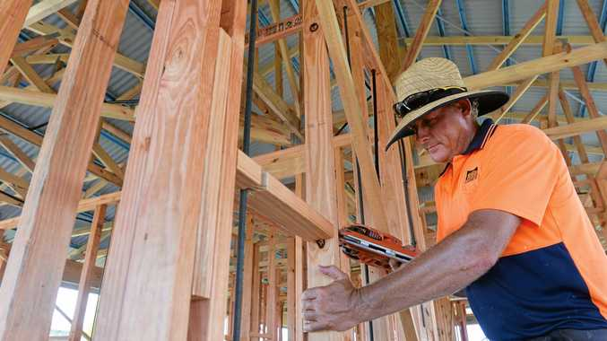 LONE TRADIE: Carpenter Warren McBean frames a house at Royal Sands. Developers of the Bucasia estate say they need at least another four tradies to get ahead of the demand for new houses, that will result in construction starting on a new home every fortnight until the end of June.