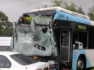 15 hurt as bus and garbage truck collide