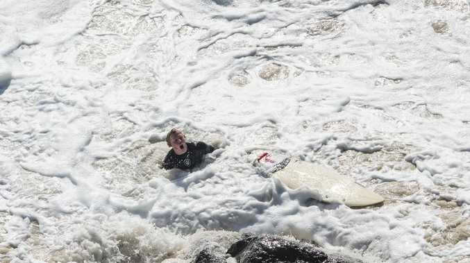 A young surfer is pummelled by waves at Duranbah on the Gold coast