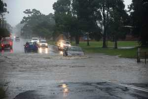 Flood waters over the road at Bray St.