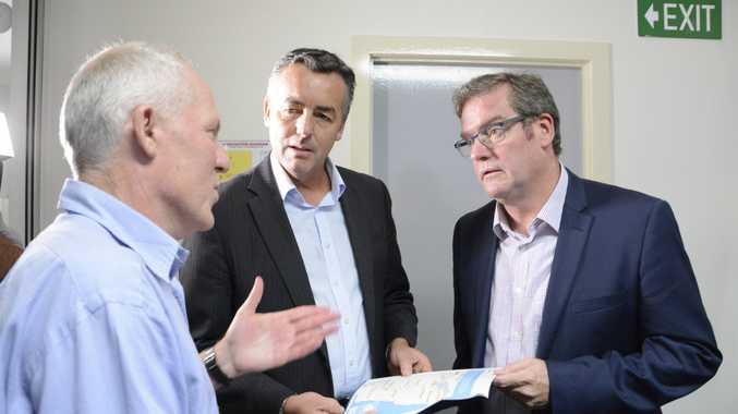 Transport Minister Darren Chester (right), talks with ARTC's Rob McNamara and Groom MP John McVeigh.