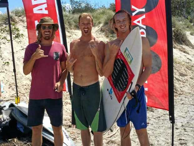 GOING FOR IT: Boardriders' Stu Campbell (right) with his support crew.