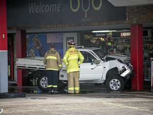 Woman seriously injured in ute crash at bottle-o