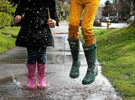 Splashing in puddles is fun no matter your age.