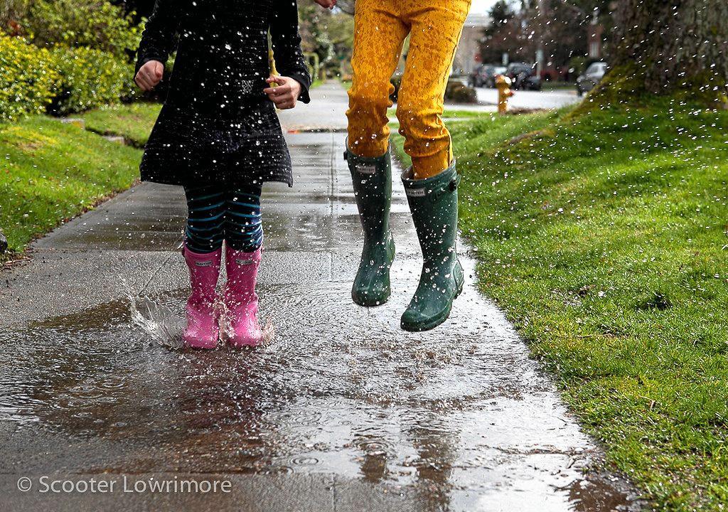Splashing in puddles is fun no matter your age.