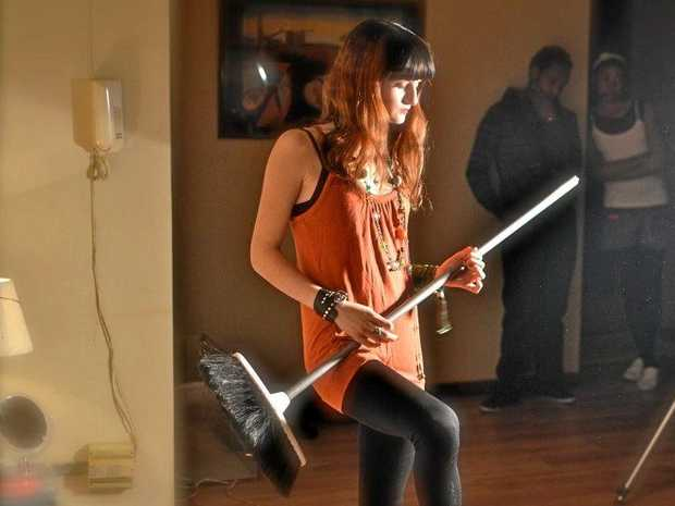 Dancing around the house is always a good rainy-day activity. Air guitar with broom optional.