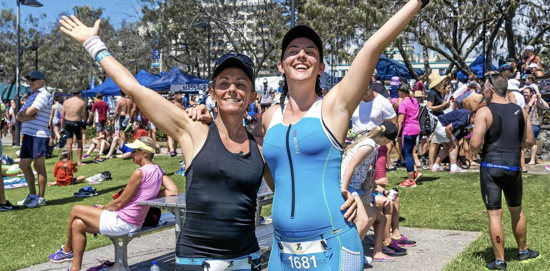 FAMILY RACE: Jenny (dark outfit) completed the Mooloolaba Triathlon alongside her pregnant daughter Jekka (blue outfit). Photo: Oliver Shearer