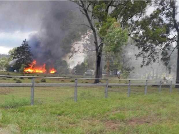 INFERNO: A fire, believed to be caused by self-combusting hay, ripped through a shed and house in Laidley South on Monday, March 13.