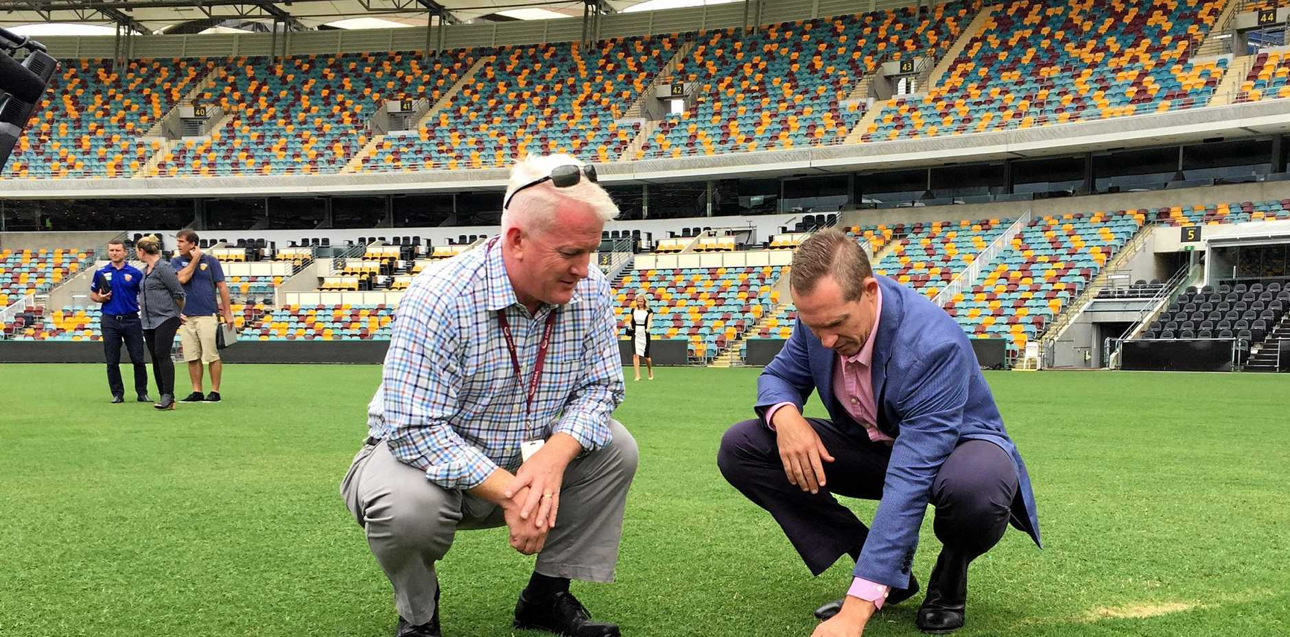 Queensland Sports Minister Mick de Brennii (right) and Gabba venue manager Blair Conaghan inspecting the pitch following the Adele concerts at the Gabba