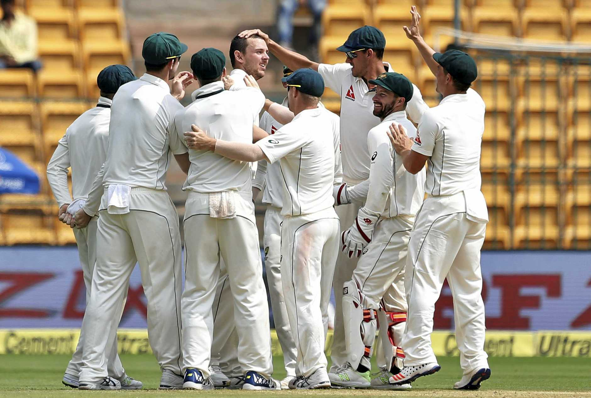 Australian players celebrate a wicket during the fourth day of their second Test.