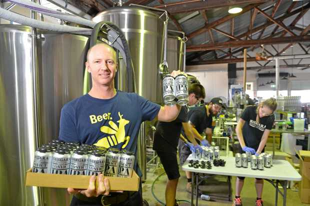 CAN IT: Owner Jack Millbank toasts the Convict IPA, the first beer canned by the Bargara Brewing Company.