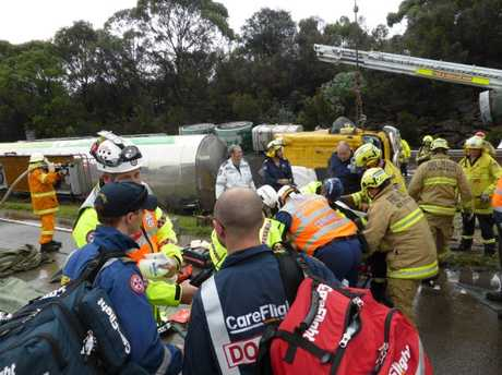 The driver was ejected from the tanker and trapped beneath the cabin. CareFlight's rapid response rescue helicopter flew to Berowra shortly after 12.30pm. Picture: CareFlight