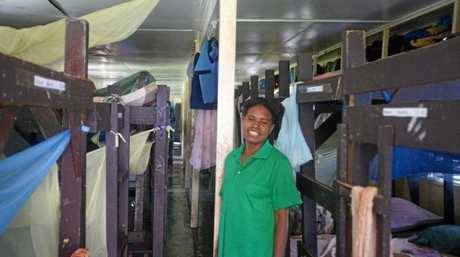 CRAMMED ROOMS: One of the students from Gabensis Primary School in the school's current dorms.