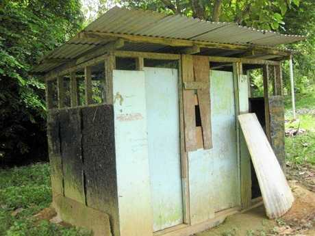 INADEQUATE FACILITIES: Close to 100 girls share two drop toilets at the school.