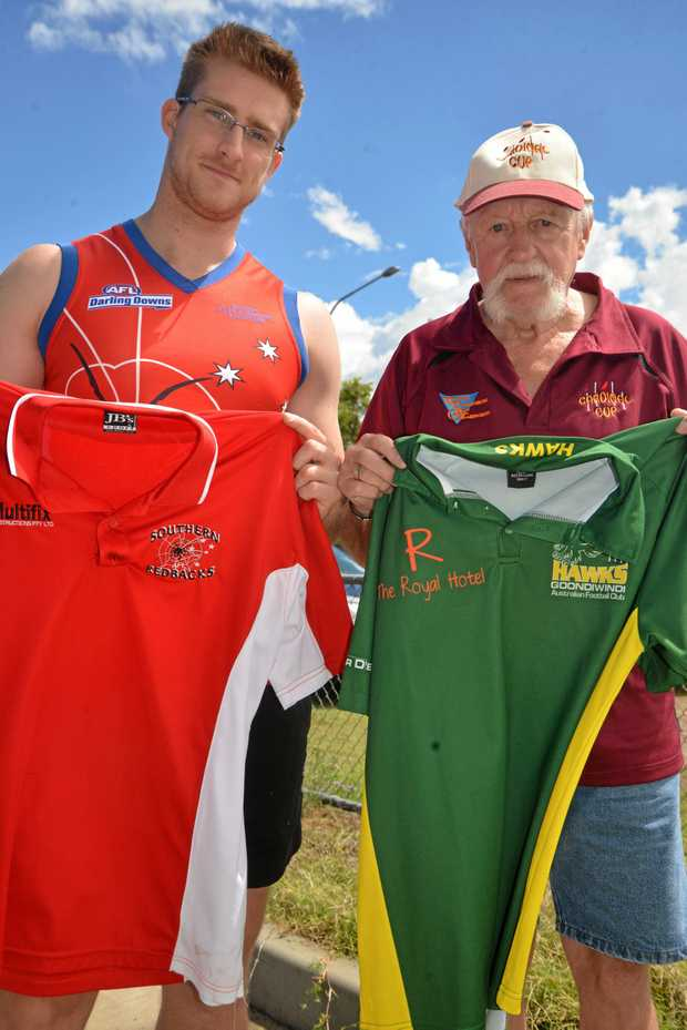 "CUP WEEKEND: Warwick Redbacks player Alex Cutmore and Colin ""Cardinal"" Pope with jerseys from some of the teams which played in the Cardinal Cup at Highfields."