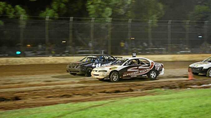 Wondai driver Josh Harm and Trent Nicola race in a production sedan heat at the Kingaroy Speedway.