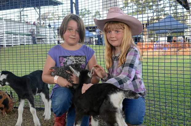 SHOW TIME: Fleur Duff and Felicity Taylor make some new animal friends at the Jandowae Show.