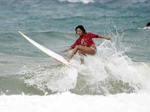 Surfers claim titles with late runs