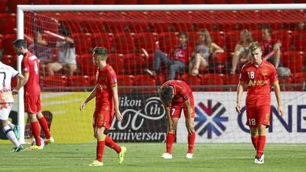 Adelaide players after their loss at an almost empty Coopers Stadium.