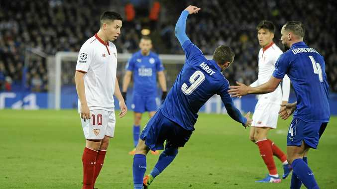 Leicester's Jamie Vardy falls after a head-butting incident with Sevilla's Samir Nasri.