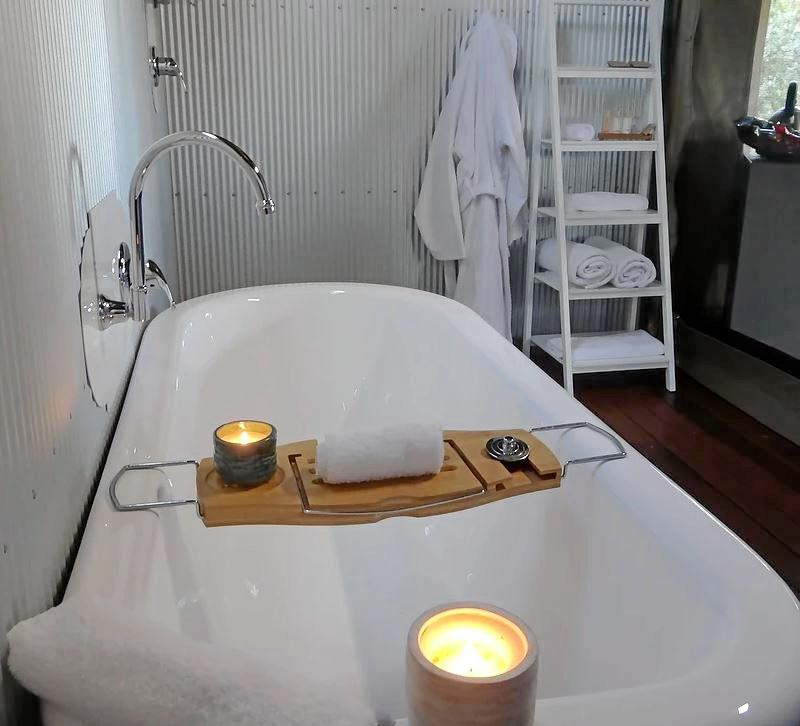 BATH TIME: Relax in a claw-foot bath in the safari tents.