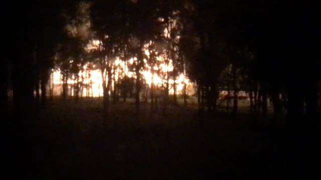 Neighbour Alan-John Knight took a photo of the house which was engulfed in flames.
