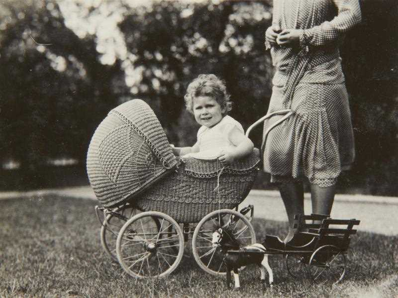 A handout photograph dated May 1928 attributed to British King George VI, when Duke of York, released by the Royal Collection Trust on 21 August 2013 showing Princess Elizabeth sitting in a wicker pram.
