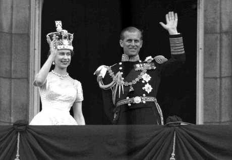 Britain's Queen Elizabeth II and Prince Philip, Duke of Edinburgh, as they wave to supporters from the balcony at Buckingham Palace, following her coronation at Westminster Abbey. London in 1953. (AP Photo/Leslie Priest, File)