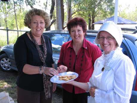 A SPOONFUL OF BUTTER. Helen Jones and Vicki Barrett take time out to enjoy some homemade butter on a biscuit from Jill Harvey at Sunday's Pioneer Day at the Brooweena Museum. Photo Erica Murree / Central & North Burnett Times