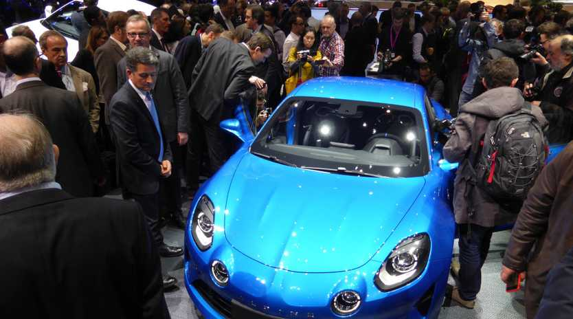 ROOM TO MOVE: New Alpine A110 sports car is swamped by a sea of people as it is unveiled at the 2017 Geneva Motor Show.