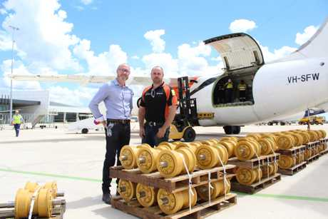 Brad Oats and Glen Blakely (left to right) standing with their cargo before it was loaded on the aircraft.
