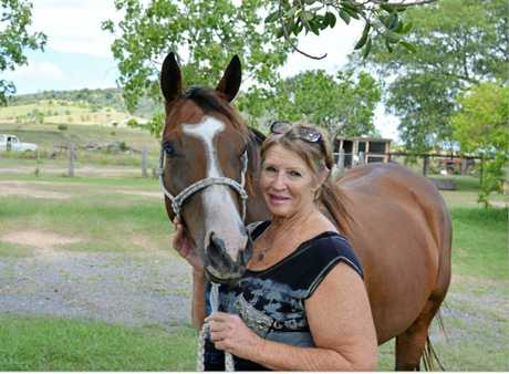 Beverley Lynch on her Hillside Property in Coolana with horse Delta.