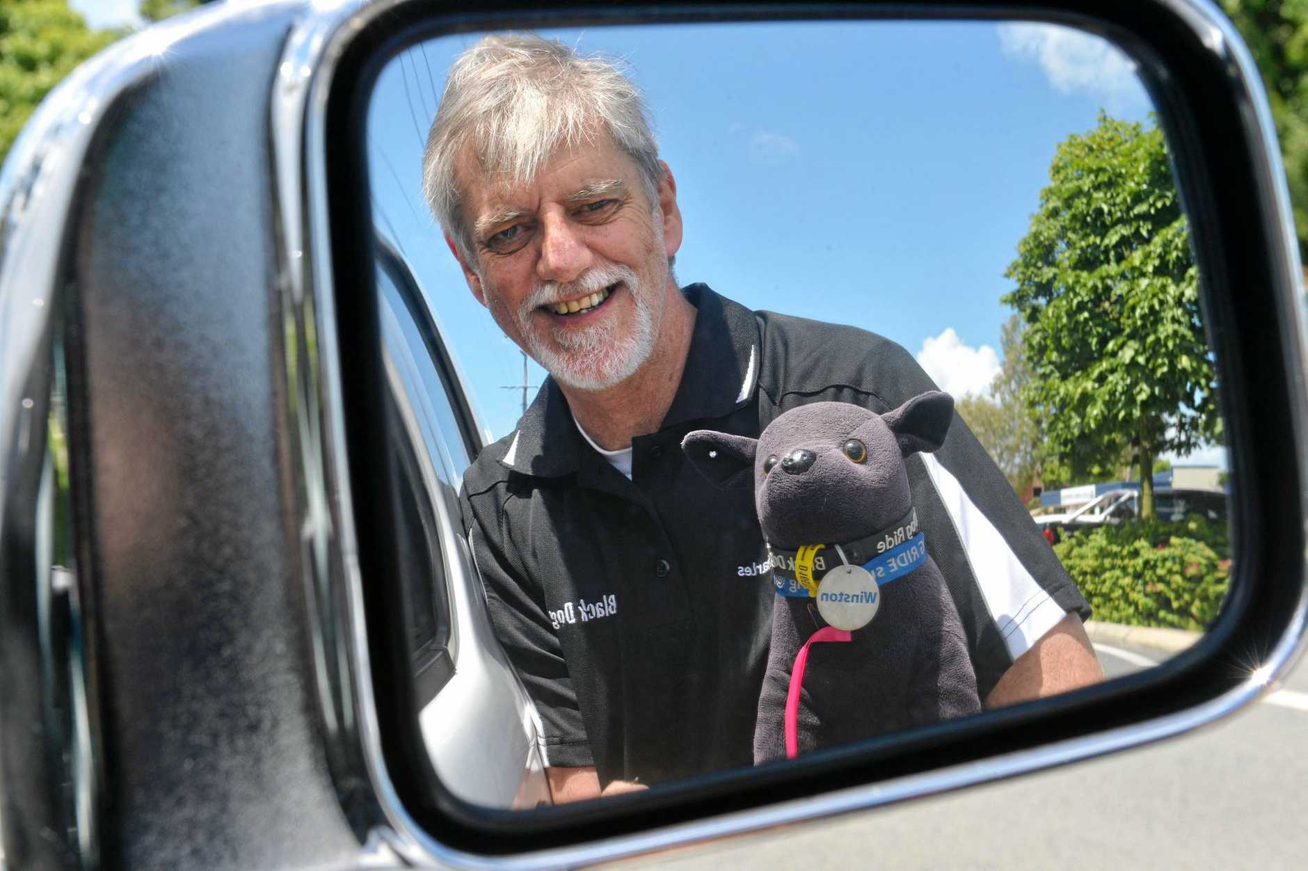 Charles Linsley and mascot Winston are all set for the Black Dog ride in Mackay this weekend.