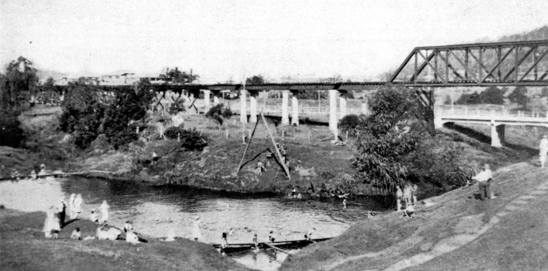 Bathers at Petrie Creek near the railway bridge in 1932.