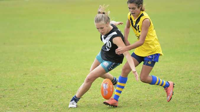 BATTLE FOR THE BALL: The addition of a new four-team Youth Girls competition for 2017 has helped  participation rates grow in the juniors by 42% since last season.