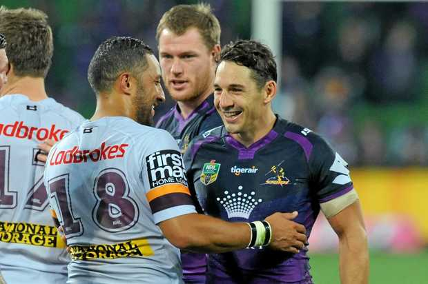 Billy Slater is congratulated by Benj Marshall of the Broncos  at AAMI Park in Melbourne
