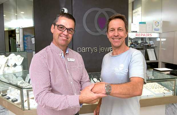 TIME FOR RECOGNITION: This month's Community Champion, Darren Squibb, receives a watch from Michael Parry at Parrys Jewellers.