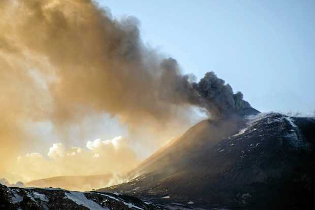 Smoke billows from Mt Etna's volcano, near Catania, in Sicily, southern Italy, on Thursday. At least 10 people were injured by volcanic rocks and steam.