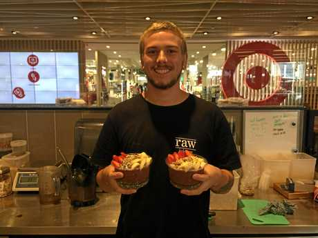 Zac from Orion Shopping Centre's Raw Juicery, with two of his acai bowls.