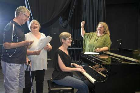 BEATING IT BACK: Taking part in the therapeutic choir at the University of Southern Queensland are (from left) Joe and Carol Chalmers with USQ music lecturer Dr Melissa Forbes (seated) and student Clare Birchley.