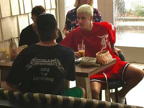 The biggest star in Sydney, Justin Bieber, stopped by a Manly cafe to try the famous Vegemite. Picture: Supplied