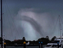 DUST DEVIL: 'Tornado' spirals above Brisbane Airport