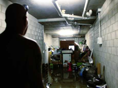 Pialba resident Warren Law is devastated that many of his belongings have been left drenched, and some destroyed, as a result of Friday night's rainfall.
