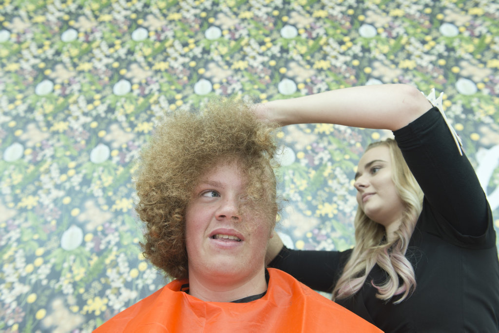 Madison Murphy gets his head shaved.