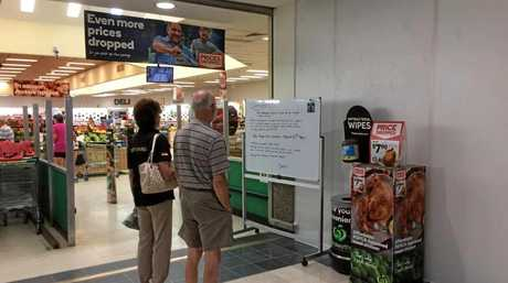 Customers read the notice at Warwick Woolworths with interest.