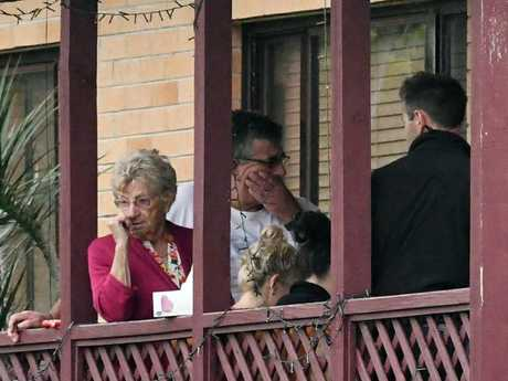 Friends and family gather at the Teasdale home in Unanderra after hearing the tragic news.Source:News Corp Australia
