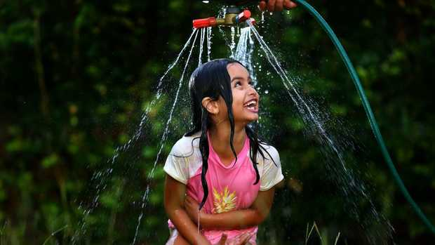 Sitting under the sprinkler to cool off, as Ava Cassar from Crestwood Heights does, might not be such a good idea if the dry conditions persist. Picture: Adam Head