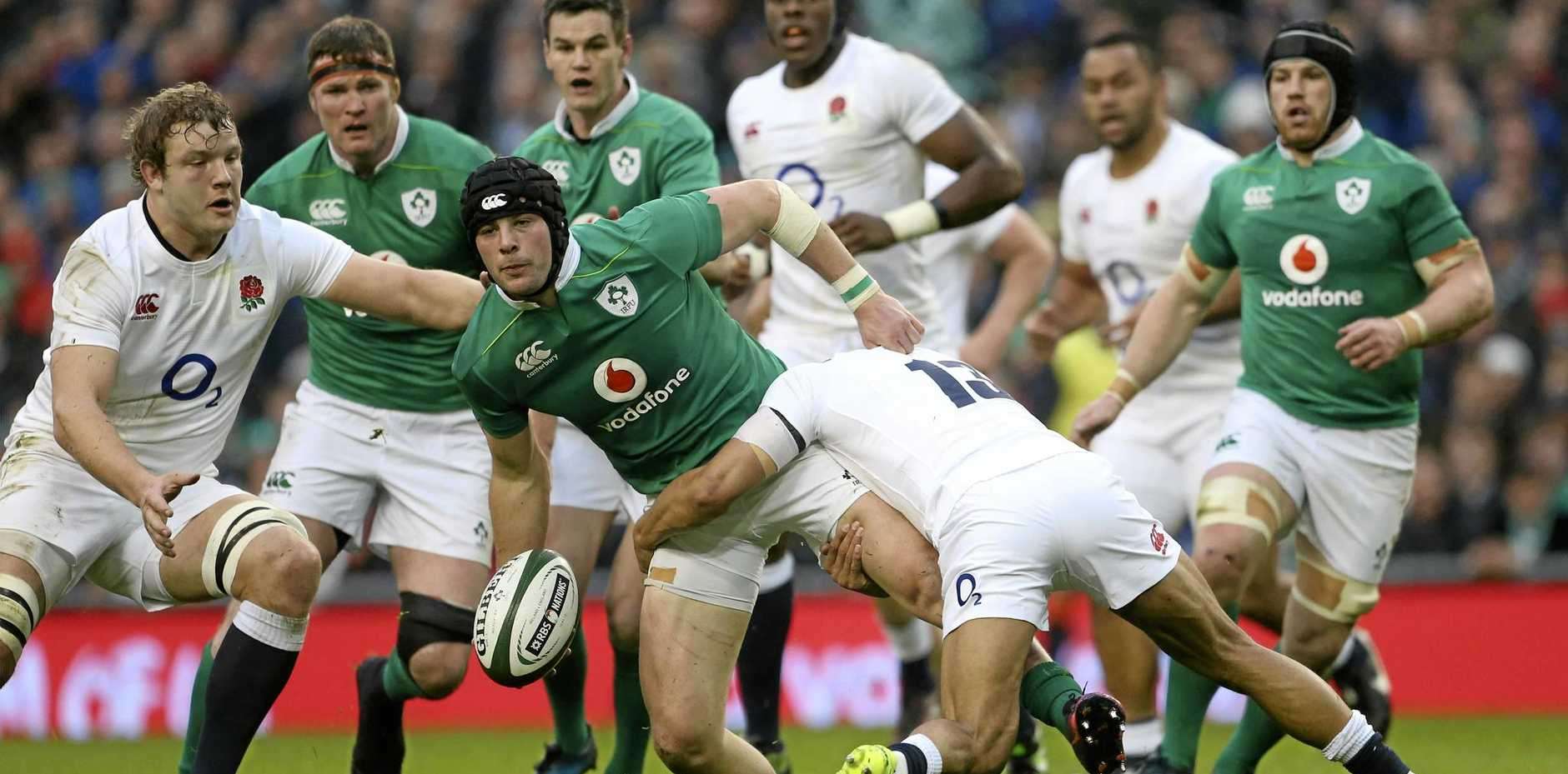 Ireland's Robbie Henshaw, hands off the ball in his country's 13-9 win over England.