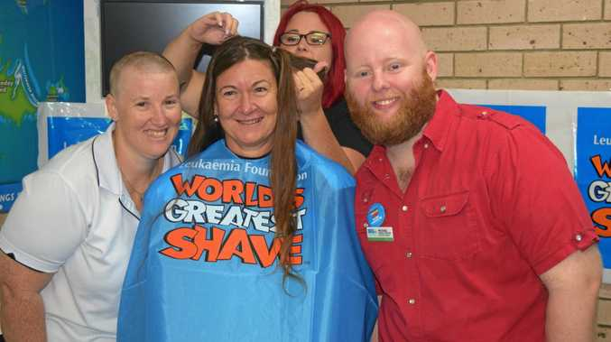 SOLIDARITY: Big 4 assistant manager Trina Halpin, Jennie Davis and general manager Michael Quigley supported the World's Greatest Shave thanks to hairdresser Belinda Ludwig.