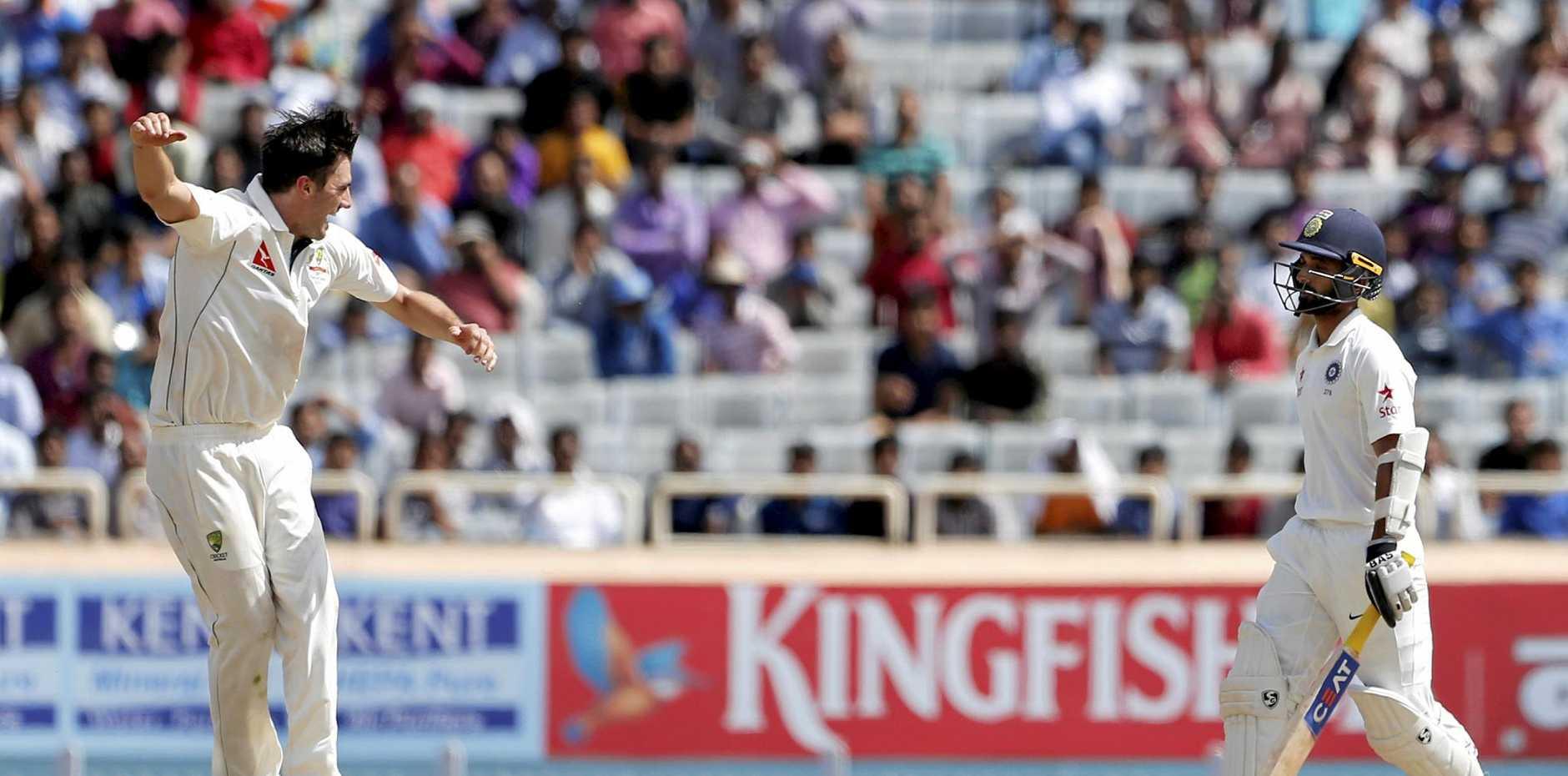 Australia's Pat Cummins celebrates the dismissal of India's Ajinkya Rahane on day three of the third Test in Ranchi.